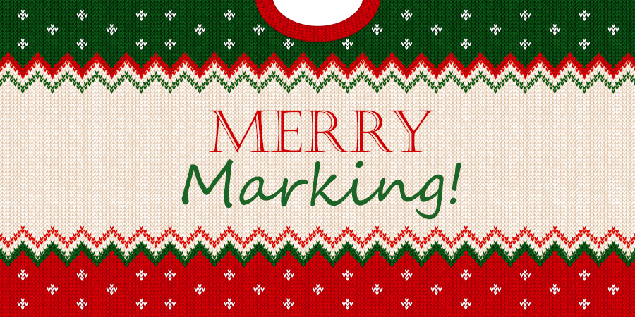 "Photo of ugly Christmas sweater saying ""Merry Marking"""