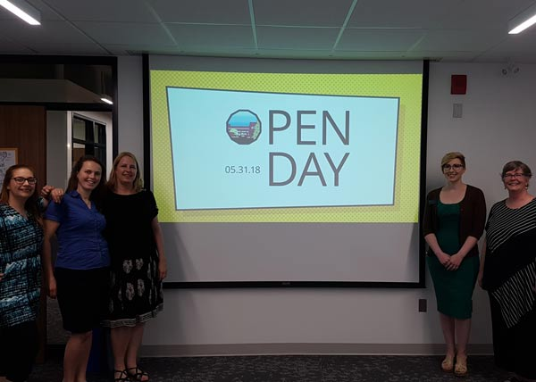 Photo from Open Day: Team standing around the slideshow