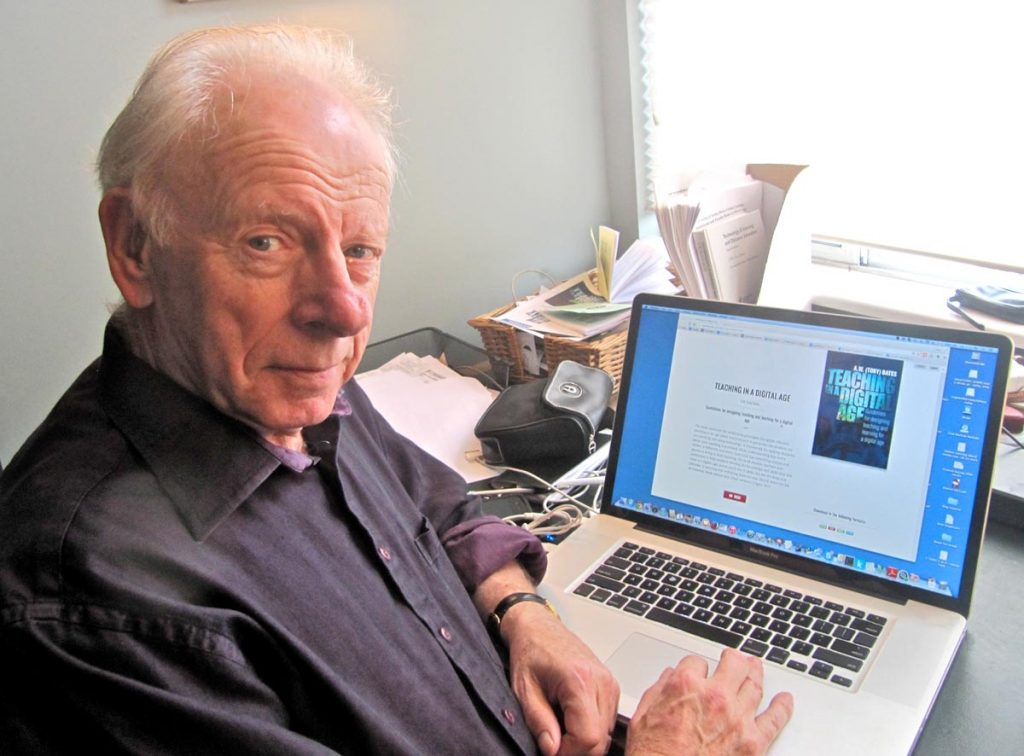 Tony Bates in front of a PC