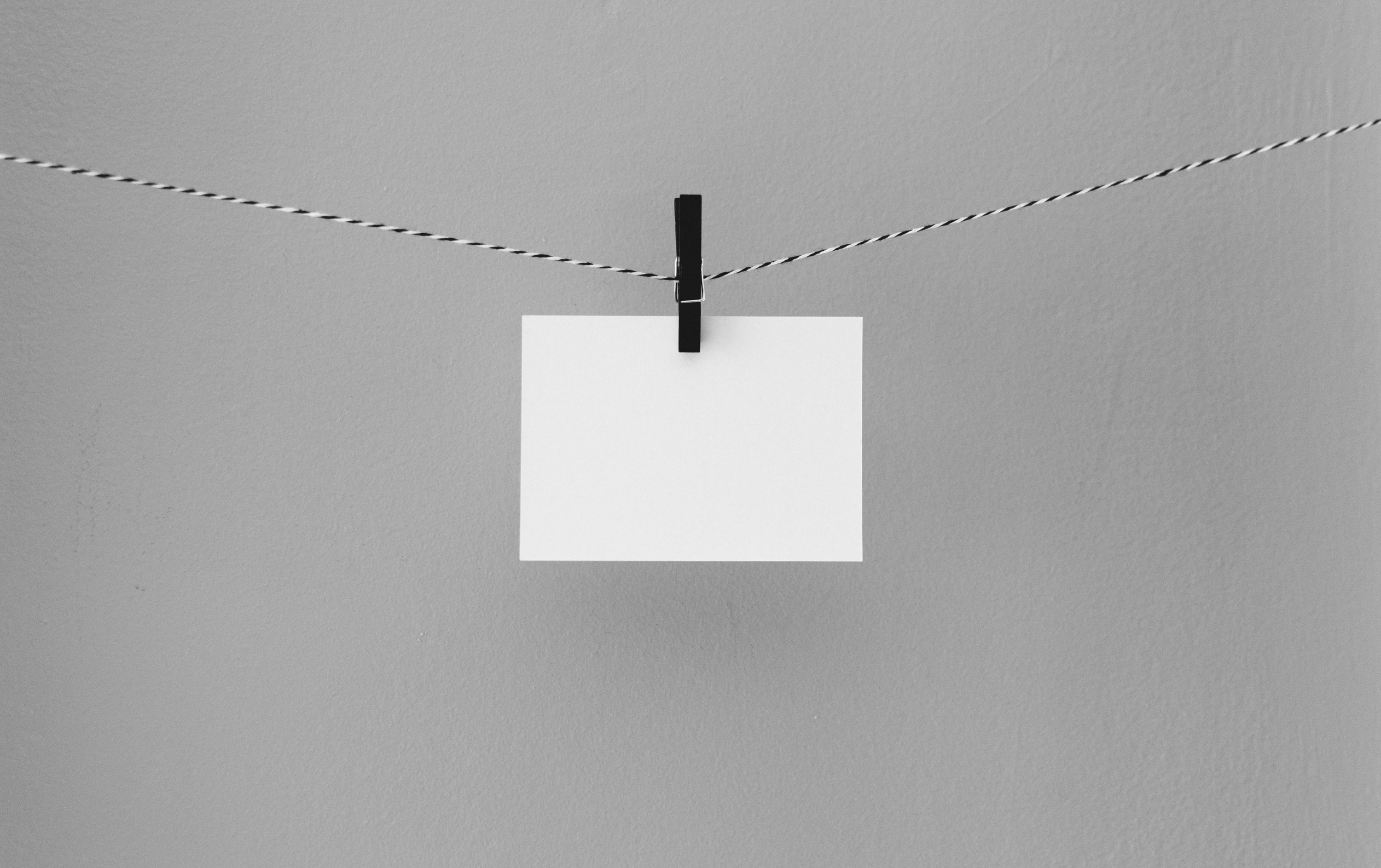 Blank card hanging on a string